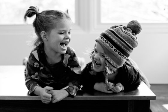 black-and-white-photo-of-two-girls-laughing-by-crystal-hardin