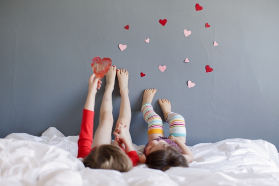 crystal-hardins-image-of-these-two-sisters-feet-on-wall-with-hearts